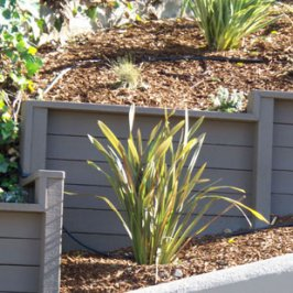Composite retaining wall timbers